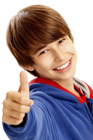Portrait of young boy showing a thumbs up photo