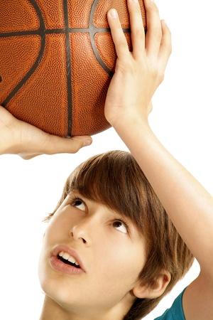 cute teen boy: Portrait of young boy with basket ball Stock Photo