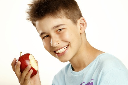 boy eat apple on white photo