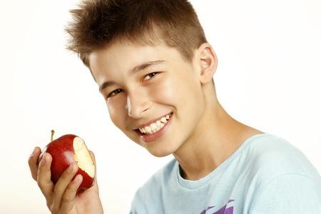 boy eat apple on white