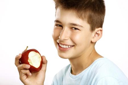 boy eat apple on white Stock Photo - 15041158