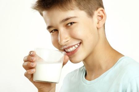 boy drink milk on white Archivio Fotografico
