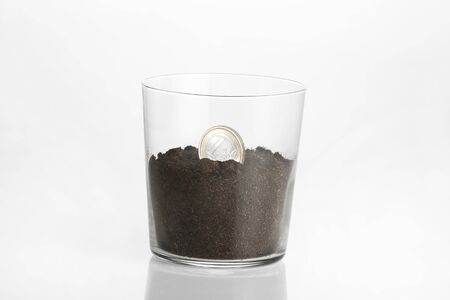 seeding: seeding of a euro coin in a transparent glass Stock Photo