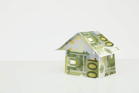 brokers: home build of money on neutal background