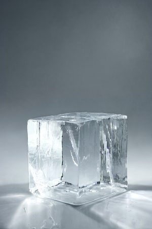 transparent big ice cube on neutral background
