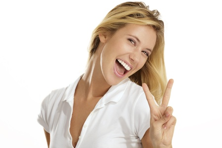 winning woman: Portrait of beautiful young woman with thumbs up gesture on white background