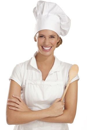 young woman chef with  different tools on white