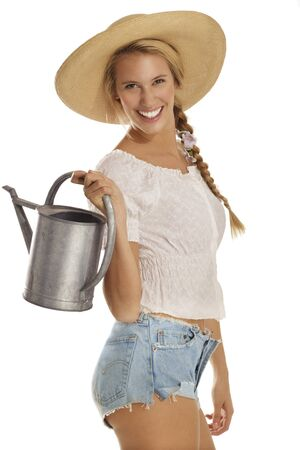 young woman gardener on white background photo