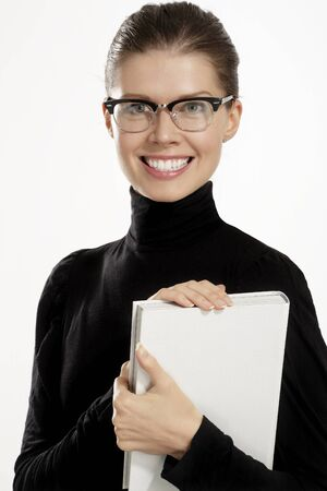 Young woman with a book on white background photo