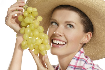 young woman showing a bunch of grapes on white photo