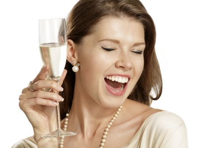 young woman with a flute of champagne on white