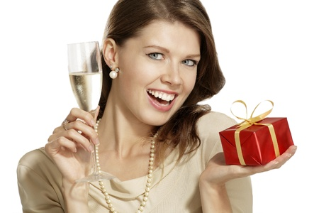 young woman with a gift on white background photo
