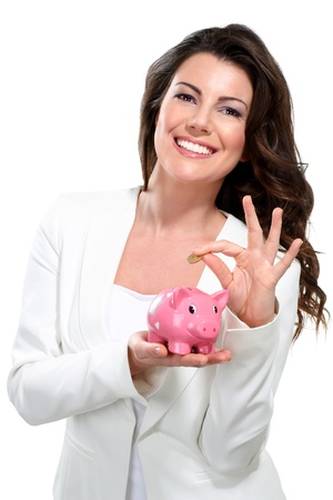 piggy bank money: Young beautiful woman standing with piggy bank money box on white