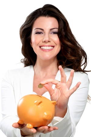 Young beautiful woman standing with piggy bank money box on white photo