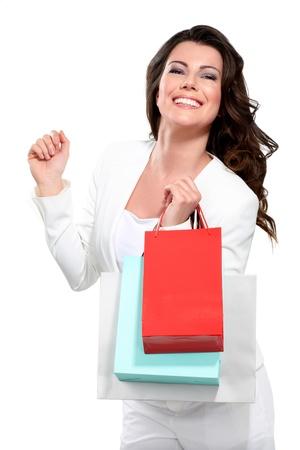 白のショッピング バッグを持つ若い美しい女性 写真素材
