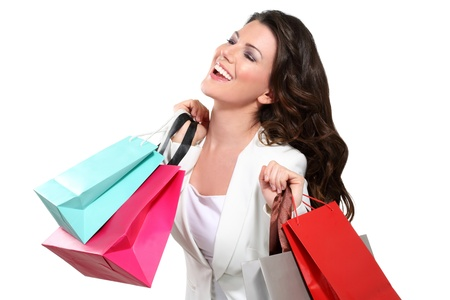 Young beautiful woman with shopping bag on white