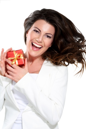 Young beautiful woman with a gift on white photo