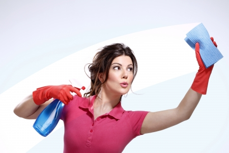 Domestic cleaning: young housewife cleaning on white Stock Photo