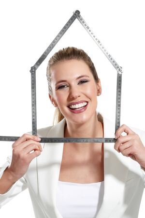 beautiful happy woman showing an house symbol  on white Stock Photo - 18498566