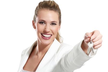 白のアパートのキーを持つ女性実業家 写真素材