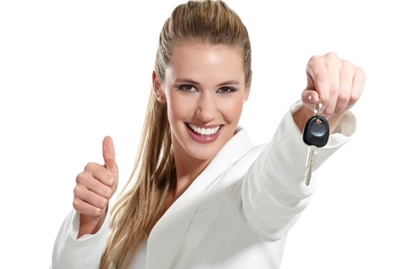 car key: beautiful woman with a keys car on white background Stock Photo