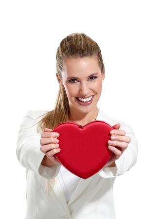beautiful happy woman with an heart on white  photo
