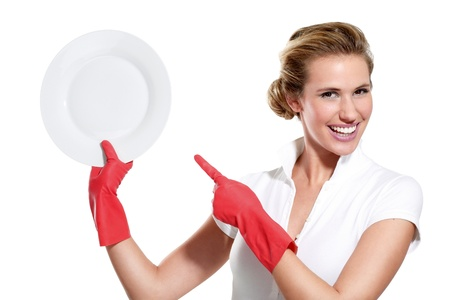 happy young housewife showing perfect clean dishes on white