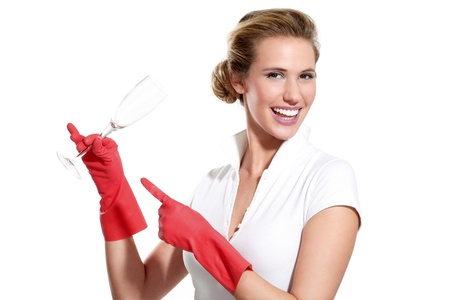happy young housewife showing perfect clean dishes on white photo
