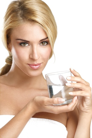 young beautiful woman drinking fresh water on white photo