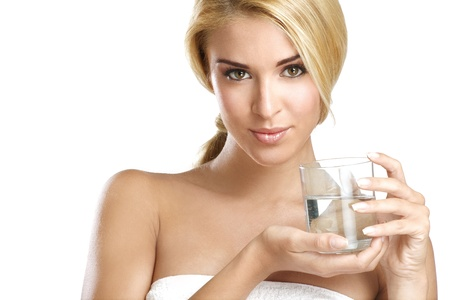 girl drinking water: young beautiful woman drinking fresh water on white