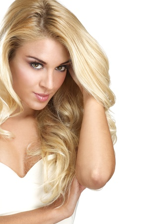 straight up: young beautiful woman showing her blonde hair on white