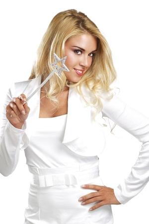 girl magic wand: young beautiful woman holding a magic wand  on white Stock Photo