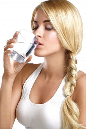 young beautiful woman drinking a glass of water on white Stok Fotoğraf