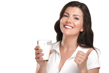 young beautiful woman drink a glass of milk on white