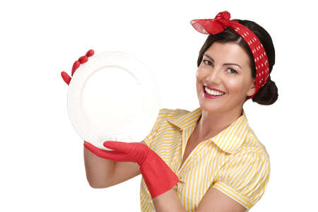 house wife: young beautiful woman housewife showing perfect washed dishes on white Stock Photo