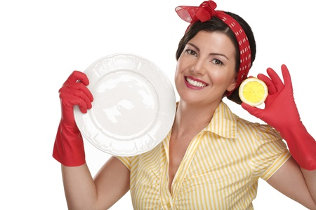 young beautiful woman housewife showing perfect washed dishes on white Standard-Bild