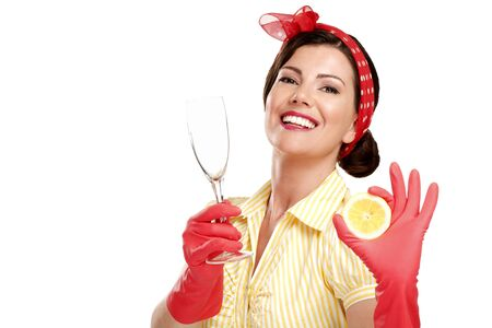 housewife gloves: young beautiful woman housewife showing perfect washed dishes on white Stock Photo