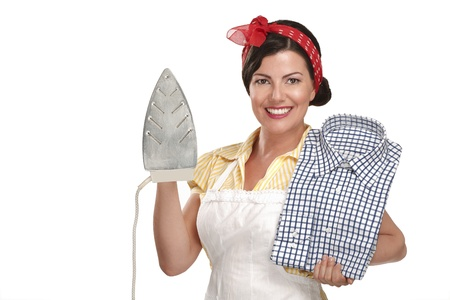 house maid: happy beautiful woman housewife ironing a shirt on white