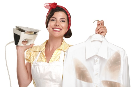 happy beautiful woman housewife ironing a shirt on white photo