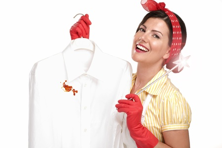 beautiful woman housewife showing a dirty shirt  on white Archivio Fotografico