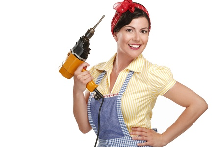 hand drill: pretty funny girl  struggling with some housework on white Stock Photo