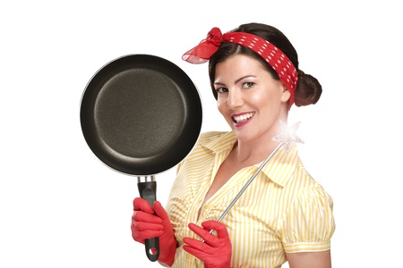dish washing: Young beautiful woman housewife showing a magic wand on dishes on white background