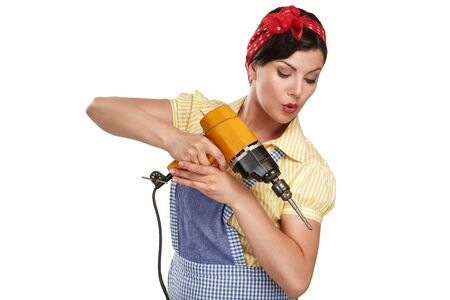 female construction worker: pretty funny girl  struggling with some housework on white Stock Photo