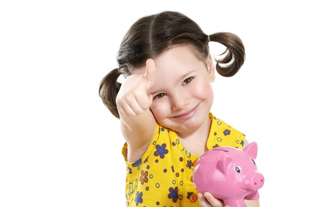 beautiful happy baby girl holding a pretty piggybank on white