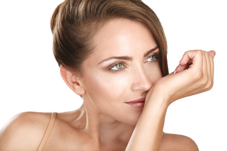 perfume woman: beautiful brunette female model smelling her perfume on white