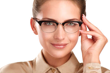 close up of a young smiling beautiful woman wearing eyeglasses  on white photo