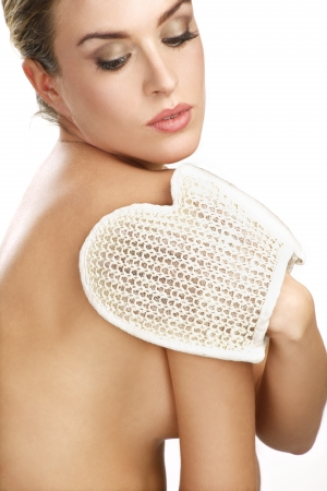 close up of a beautiful woman using a scrub glove  on white photo