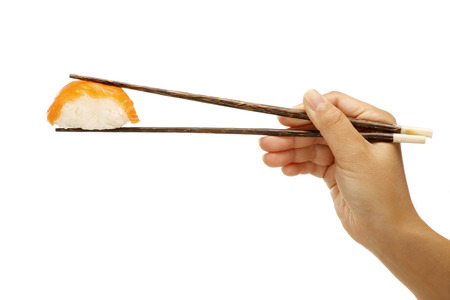 female hand holding sushi sashimi asian food on white
