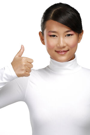 Beautiful happy asian girl showing thumbs up on white photo