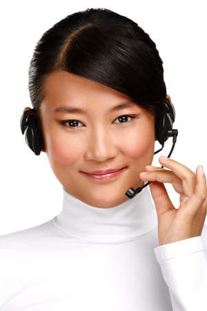 Happy smiling female asian customer service operator on white photo